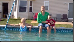 foot in pool with kids